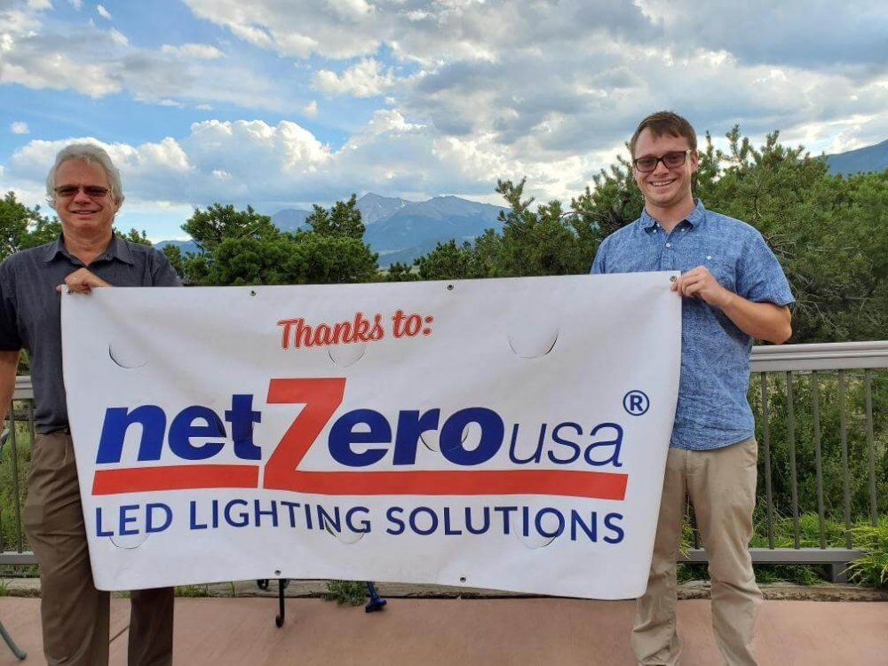Ryan and Chris Martin holding NetZero banner